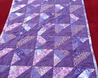23x17 baby doll quilt.   Shades of purple brighten this little patchwork doll quilt.