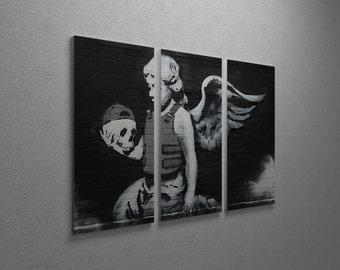 "Banksy Body Armor Angel Gallery Wrapped Canvas Triptych Print 48"" x 30"""