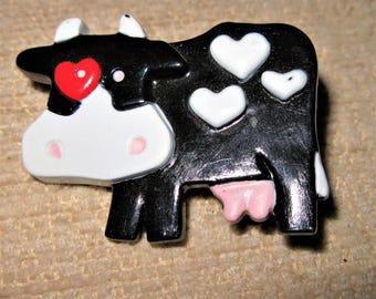 Resin cow brooch