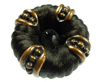 Buttons, thread and a bead brown