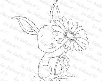 Bunny holding flower