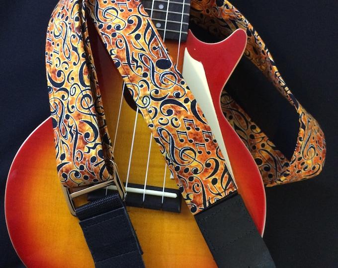 Ukulele strap, mandolin strap or child-sized guitar strap // handmade retro nostalgia black musical notes on an orange/yellow background