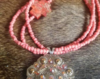 Coral crosses and seed bead