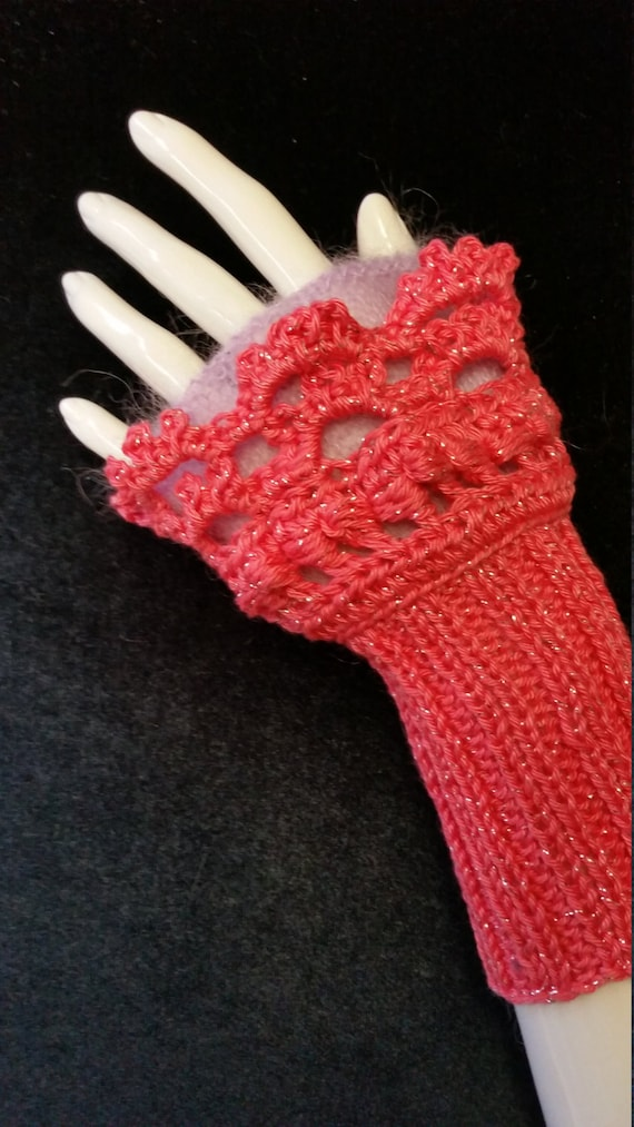 L345.  Wristlets .  Hand knitted wristlets with crochet finish