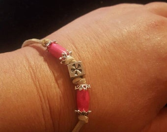 Handmade bracelet on beigh leather with silver cube charm and wooden beads