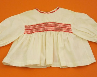 vintage white blouse with red smocking