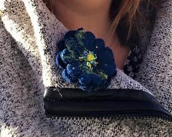 Blue hand felted, beaded brooch.