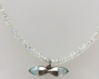 Rainbow moonstone rondelle necklace with faceted blue topaz bullets.