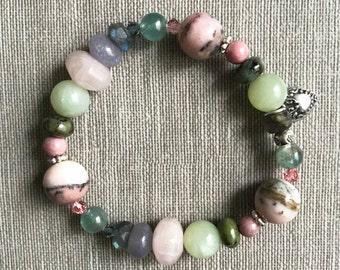 Opal, jade, rose quartz, labradorite, jasper, lepidolite, rhodonite, apatite, Swarovski crystal, and sterling silver gemstone bracelet