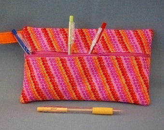 "Pink/Orange Multi dotted stripe 9"" zipper Pouch"