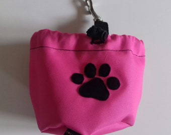 Pink dog treat pouch with a paw