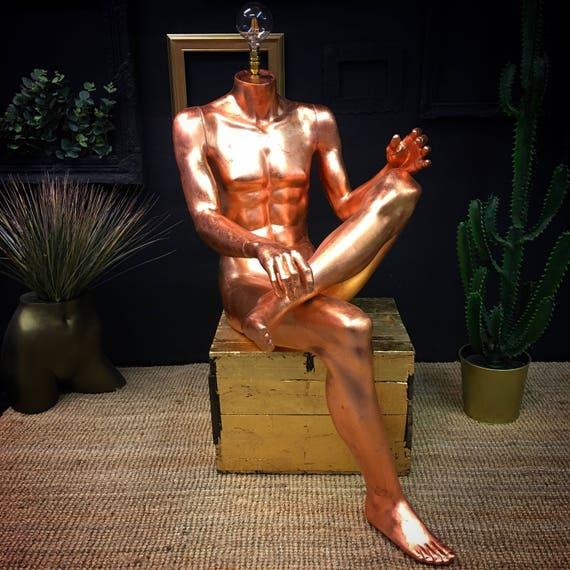Sitting male lamp copper