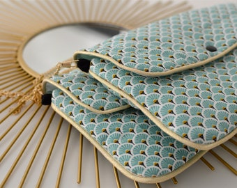 BLUE SCALES turquoise and gold clutch bag