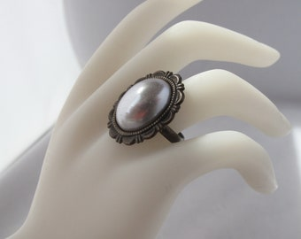 Grey Acrylic Pearl Costume Ring on adjustable Antique Brass band