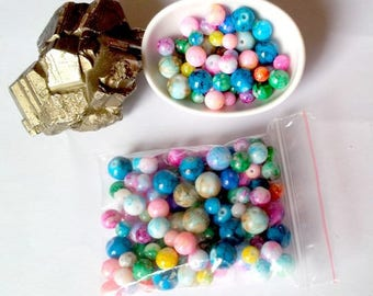 100 multicolored, round, 4-10 mm mottled glass beads