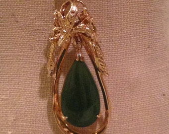teardrop jade necklace in gold over sterling pendant frame chain is 12k GF. circa 1960's
