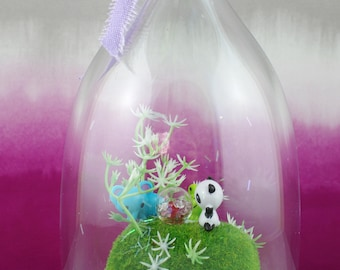 Small handmade cloche diorama. Panda, frog and elephant on a mossy rock with sparkly orb.