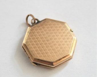Vintage gold back and front locket. Hexagonal locket. Gold bk and ft locket