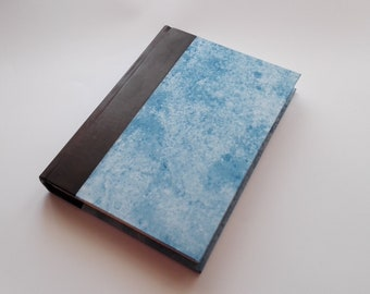 Diary in half-leather and hand-decorated paper