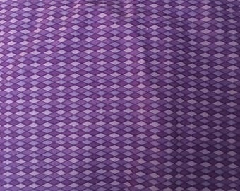 Harlequin print in shades of purple Fabric