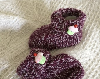 Baby booties handknitted with cupcake button! Lovely baby gift.