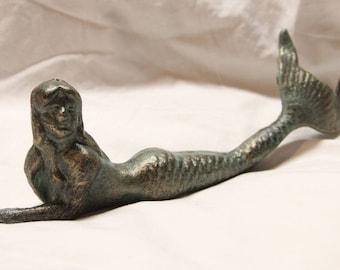 Cast iron mermaid novelty figurine.  All metal