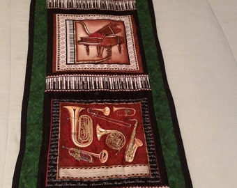 quilted table  runner-bed runner or wall hanger featuring musical apliques