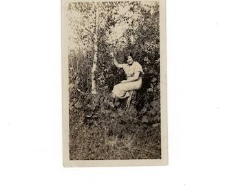 Woman among the trees, vintage snapshot photo