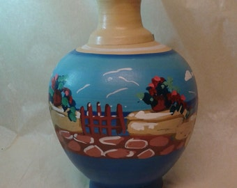 A handmade and handpainted Greek museum replica vase