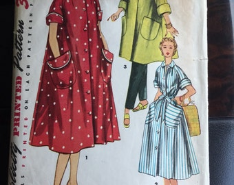 """Simplicity 4471; ©1953; Misses' and Women's Robe in Two Lengths: """"Simple to Make"""" robe is styled with cuffed raglan sleeves."""