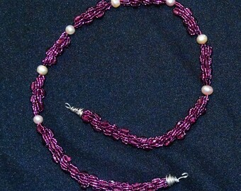 purple spiral cord and pink pearl necklace