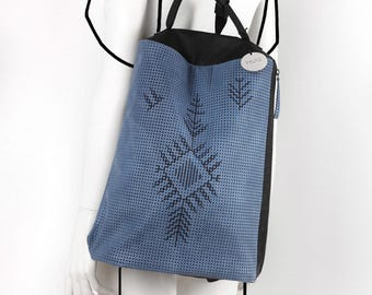Leather blue perforated embroidered backpack