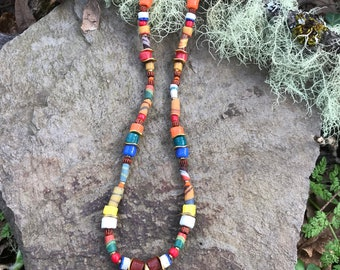Bright and fun ethnic Necklace, African inspired using recycled glass beads from Africa, brass symbol pendant.