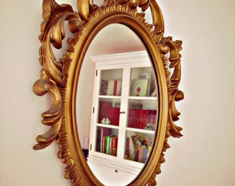 Mirror gold old flea market ornamented Florentine style. Made in Italy
