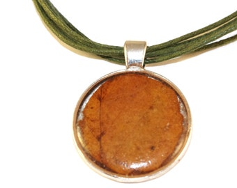 nature pendant with brown leaf