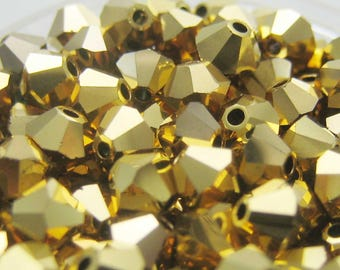Set of 20 beads Swarovski Aurum bicones - 4 mm
