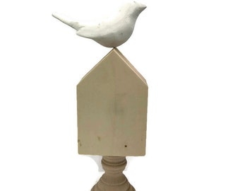ready to decorate plaster hand   cast bird  on wooden house  with  pedestal