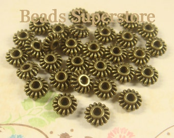 7 mm x 3 mm Antique Bronze Spacer Bead - Nickel Free, Lead Free and Cadmium Free - 25 pcs