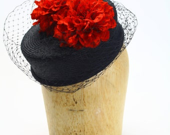 Black Straw Fascinator Cocktail Pillbox Summer Hat with Red Fabric Flowers and Cage Veil #WomensHats #Millinery #PennyHats #KateMiddleton
