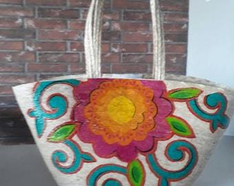 Handmade palm bag decorated with Flo design