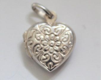 Silver locket.  Sterling silver heart locket. Vintage locket