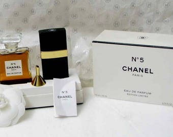 CHANEL perfume, a limited edition of the number 5 with a spray of bag