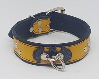 """Hand made yellow """"Batman"""" collar."""