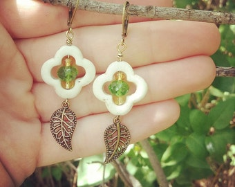 Carved White turquoise flowers with  lime green and gold crystal centers, and antique brass filigree leaves dangle earrings