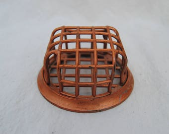 Cage style flower frog copper colored