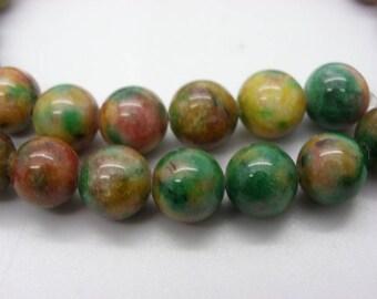 a beautiful 42 jade 10 mm beige green rust dyed