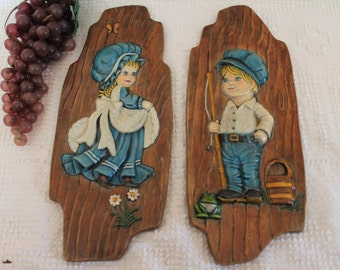 "12"" Ceramic Wall Plaques of Boy and Girl Dressed in Blue and White"