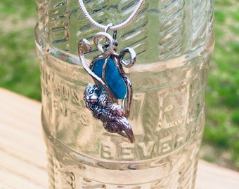 Sterling silver River otter on river grass wrapped around blue apatite and blue apatite earrings.