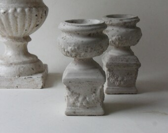 two cement urns