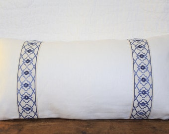 Rectangular ivory pillow cover with blue trim